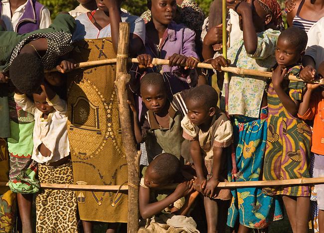 Children watching Gulewamkulu dancers (and keeping an eye on the photographer)