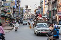 Nepal, Kathmandu.  Traffic on Putali Sadak Street.  Riding without Seat Belt.  Driving on the Left.