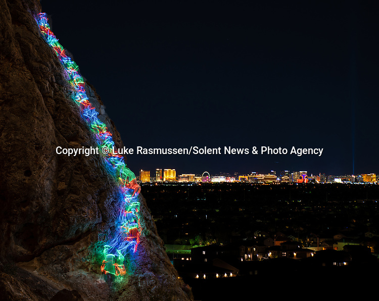 """Pictured:  A 2 minutes 51 seconds exposure at Urban Crag, Las Vegas, NV<br /> <br /> Bright bolts of colourful light snake their way across mountains and cliffs.  The striking images were created by a rock climber who wrapped LED lights around his body before capturing long exposure shots of his route.<br /> <br /> Luke Rasmussen took the photos in the deserts of Nevada, in the United States, and admits that his method of 'freezing time in a moment' is unusual.  The 28 year old photographer said: """"Wearing a sweater full of lights and climbing through the darkness of night is certainly a different experience than most climbers will get.  SEE OUR COPY FOR DETAILS.<br /> <br /> Please byline: Luke Rasmussen/Solent News<br /> <br /> © Luke Rasmussen/Solent News & Photo Agency<br /> UK +44 (0) 2380 458800"""