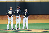 Grant Shambley (43), Evan Stephens (5) and Joey Rodriguez (7) stand for the National Anthem prior to the game against the Florida State Seminoles at Wake Forest Baseball Park on April 19, 2014 in Winston-Salem, North Carolina.  The Seminoles defeated the Demon Deacons 4-3 in 13 innings.  (Brian Westerholt/Four Seam Images)