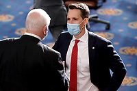 United States Senator Josh Hawley (Republican of Missouri) is seen prior to a joint session of Congress to count the Electoral College votes from the 2020 presidential election on Wednesday, January 6, 2021.<br /> CAP/MPI/RS<br /> ©RS/MPI/Capital Pictures