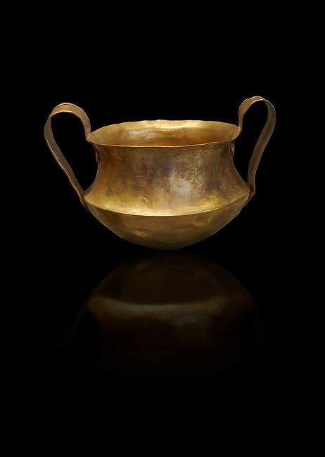 Two handled Mycenaean gold bowl cup from the Kakovatos tholos tomb, Trifylia, Greece. National Archaeological Museum Athens. Black Background<br /> <br /> Kakovatos is a significant site of the early Mycenaean period of Greece (c. 16th to 15th century BC) on the west coast of the Peloponnese (Zacharo, Nomos Elis) and became widely known through the excavations of three large tholos tombs by Wilhelm Dörpfeld in 1907–1908.
