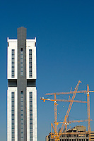 Construction cranes help build a new high rise in Charlotte, NC.