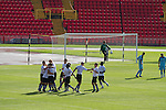 Gateshead 1 Cambridge United 1, 17/09/2011. Gateshead International Stadium, Football Conference. The home players celebrating Josh Gillies equalising goal at the Gateshead International Stadium, the athletics stadium which is also the home ground of Gateshead FC (in white), as the club play host to Cambridge United in a Blue Square Bet Premier division fixture. The match ended in a one-all draw, watched by a crowd of 904. The point meant Gateshead went to the top of the division, one below the Football League in England. Photo by Colin McPherson.