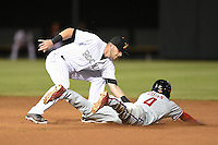 Salt River Rafters infielder Trevor Story (8) tags Roman Quinn (4) sliding into second during an Arizona Fall League game against the Scottsdale Scorpions on October 7, 2014 at Salt River Fields at Talking Stick in Scottsdale, Arizona.  Scottsdale defeated Salt River 7-4.  (Mike Janes/Four Seam Images)