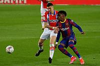 13th February 2021; Camp Nou, Barcelona, Catalonia, Spain; La Liga Football, Barcelona versus Deportivo Alaves; Junior Firpo of Barcelona held off the ball by Battaglia of Deportivo