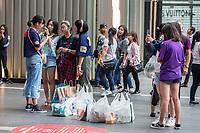 Young Malaysian Girl Shoppers at Pavilion Mall, Kuala Lumpur, Malaysia.