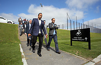 Pictured: Landon Donovan (2nd L) walks from one of the pitches Tuesday 04 April 2017<br />Re: Official opening of the Fairwood Training Complex of Swansea City FC, Wales, UK