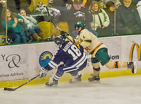 4 January 2014:  University of Vermont Catamount Defenseman Nick Bruneteau, a Senior from Omaha, NB, gets his stick caught in the seam of the glass during the third period against the Yale University Bulldogs at Gutterson Fieldhouse in Burlington, Vermont. With an empty net and seconds remaining, the Cats came back to tie the game 3-3 against the 10th seeded Bulldogs. Mandatory Credit: Ed Wolfstein Photo *** RAW (NEF) Image File Available ***