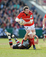 Peter O'Mahony of Munster Rugby is tackled by Tom Casson of Harlequins during the Heineken Cup quarter final match between Harlequins and Munster at the Twickenham Stoop on Sunday 7th April 2013 (Photo by Rob Munro)