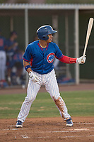 AZL Cubs 2 catcher Henderson Perez (8) at bat during an Arizona League game against the AZL Reds at Sloan Park on June 18, 2018 in Mesa, Arizona. AZL Cubs 2 defeated the AZL Reds 4-3. (Zachary Lucy/Four Seam Images)