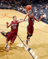 Nov 6, 2010; Charlottesville, VA, USA; Roanoke College Corey Poindexter (3) grabs a rebound Saturday afternoon in exhibition action at John Paul Jones Arena. The Virginia men's basketball team recorded an 82-50 victory over Roanoke College.