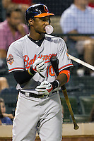 Baltimore Orioles outfielder Adam Jones #10 on deck during the Major League Baseball game against the Texas Rangers on August 21st, 2012 at the Rangers Ballpark in Arlington, Texas. The Orioles defeated the Rangers 5-3. (Andrew Woolley/Four Seam Images).