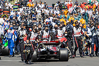 18th July 2021; Silverstone Circuit, Silverstone, Northamptonshire, England; Formula One British Grand Prix, Race Day; Alfa Romeo Racing Orlen driver Kimi Raikkonen arrives onto a packed grid