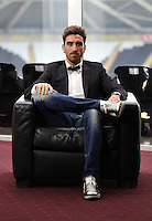 Pictured: The all new look Chico Flores, footballer for Swansea City FC, during an interview at the Liberty Stadium. Tuesday 02 April 2014