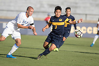 BERKELEY, CA - Oct. 13, 2016: Cal's (3) Shinya Kadono scrambles for a loose ball against UCLA's (4) Erik Holt.  Cal Men's Soccer played UCLA on Goldman Field at Edwards Stadium.