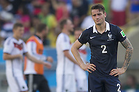 Mathieu Debuchy of France looks dejected
