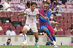 FC Barcelona's Ronald Araujo (r) and Getafe CF's Enes Unal during La Liga match. August 29, 2021. (ALTERPHOTOS/Acero)