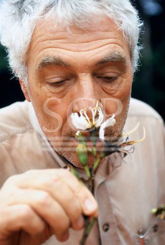 Makande, Gabon. Botanist Frans Breteler smelling a flower specimen from the rainforest canopy.