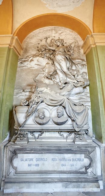 Picture and image of the stone sculpture of an angel over the sarcophagus of Salvatore and Rosa Queirolo, sculpted by G Navone, 1901. Section A, no 16, The monumental tombs of the Staglieno Monumental Cemetery, Genoa, Italy