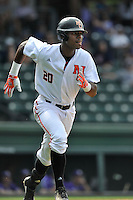 Center fielder Kyle Lewis (20) of the Mercer Bears runs to first after hitting a home run in a SoCon Tournament game against the Furman Paladins on Thursday, May 26, 2016, at Fluor Field at the West End in Greenville, South Carolina. Mercer won, 6-1. Lewis is considered a 2016 Top 5 draft pick. (Tom Priddy/Four Seam Images)
