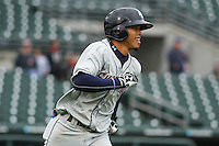 Colorado Springs Sky Sox shortstop Orlando Arcia (2) runs to first base during a Pacific Coast League game against the Iowa Cubs on May 1st, 2016 at Principal Park in Des Moines, Iowa.  Colorado Springs defeated Iowa 4-3. (Brad Krause/Four Seam Images)