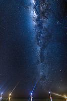 Beautiful Milky Way galaxy and starry sky above boats' light rays, in Rangiroa Tuamotus atoll, French Polynesia, South Pacific Ocean