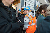 A worker crosses the picket line. Electricians and supporters picket Blackfriars Station Redevelopment construction site to protest at plans by contractor Balfour Beatty to cut wages by 35%.