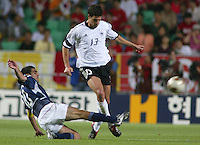 Claudio Reyna tackles the ball away from Michael Ballack. The USA lost to Germany 1-0 in the Quarterfinals of the FIFA World Cup 2002 in South Korea on June 21, 2002.