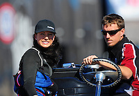 Oct. 29, 2011; Las Vegas, NV, USA: NHRA pro mod driver Leah Pruett (left) with a crew member during qualifying for the Big O Tires Nationals at The Strip at Las Vegas Motor Speedway. Mandatory Credit: Mark J. Rebilas-