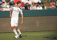 LA Galaxy defender Omar Gonzalez (4) looks upfield for an open teammate. The LA Galaxy defeated the Houston Dynamo 4-1 at Home Depot Center stadium in Carson, California on Saturday evening June 5, 2010..