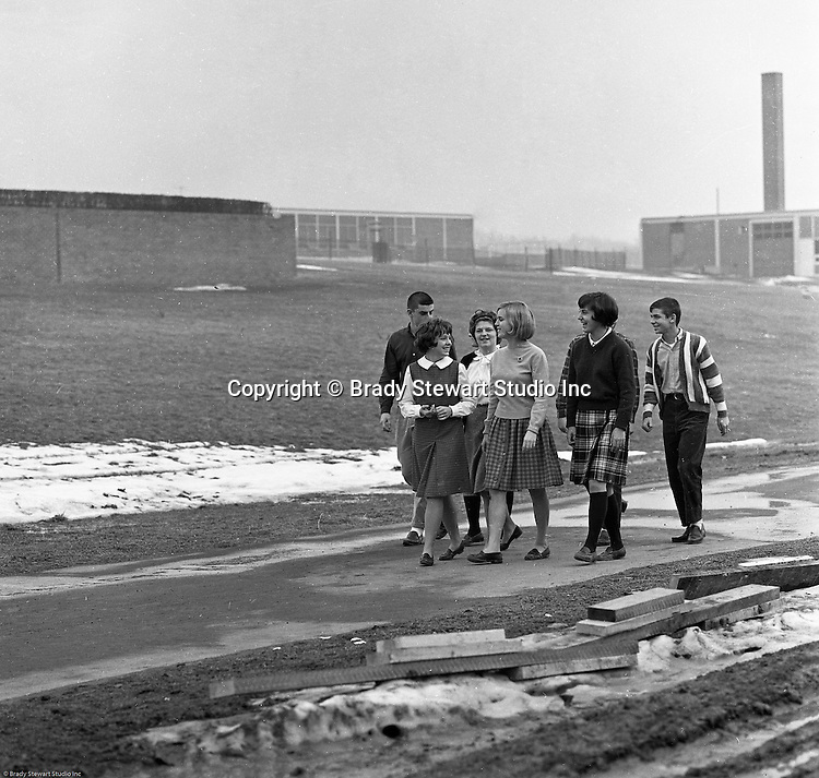 Bethel Park Senior High School:  View of students walking to the cafeteria. The new Bethel Senior High School was dedicated on October 23, 1960, but the campus would not grow to its current size until seven years later. Phase II of the construction was completed in 1964 with the addition of another academic building and the industrial arts building. Phase III was completed in 1967 with the construction of the fourth academic building and a 6,300 seat football stadium and track, three tennis courts, seven basketball courts, and a baseball field.