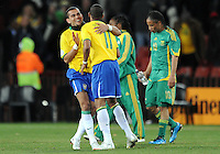 Dani Alves of Brazil is embraced by team-mate Robinho at full-time as Steven Pienaar of South Africa looks dejected. Brazil defeated South Africa 1-0 during the semi-finals of the FIFA Confederations Cup at Ellis Park Stadium in Johannesburg, South Africa on June 25, 2009..