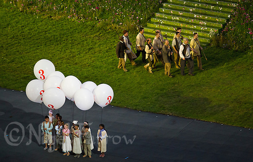 27 JUL 2012 - LONDON, GBR - Children hold balloons for the countdown for the 9pm start of the Opening Ceremony of the London 2012 Olympic Games in the Olympic Stadium in the Olympic Park, Stratford, London, Great Britain (PHOTO (C) 2012 NIGEL FARROW)