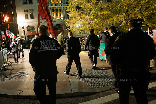 New York, New York.November 15, 2011..The Occupy Wall Street encampment in Lower Manhattan's Zuccotti Park / Liberty Plaza was evicted in the middle of the night by the New York Police Department and the Department Of Sanitation removed tents and personal belongings of the protestors...Over 70 demonstrators were arrested.  Police Commissioner Raymond W.  Kelly at the scene. (center)