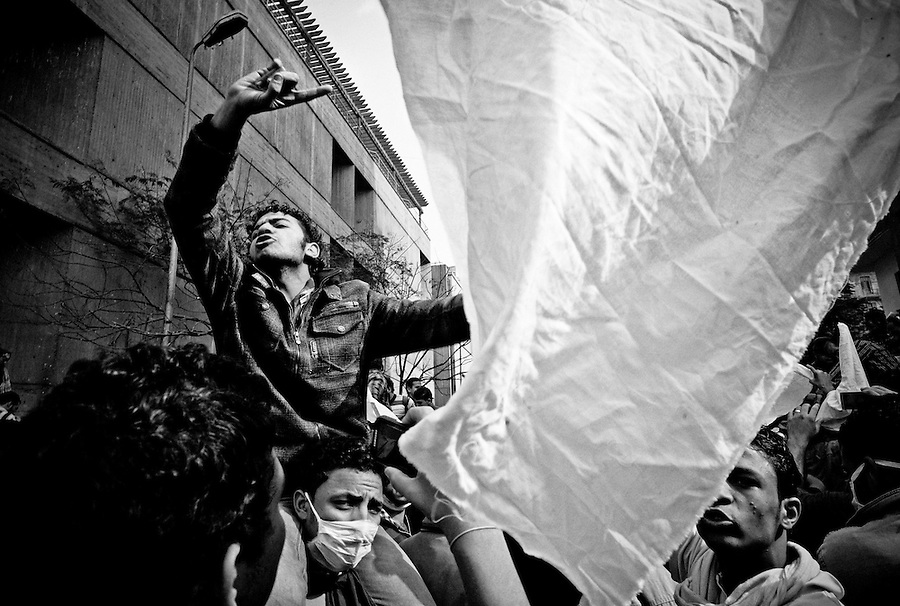 Egyptian protestors shout anti-military slogans while waving white peace flags near Tahrir Square, Cairo, Egypt, Thursday, Nov. 24, 2011. After five consecutive days of violent clashes between protestors and security forces in Cairo, both sides seem to be observing a tenuous truce on Thursday morning.