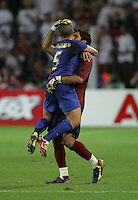 Italian captain (5) Fabio Cannavaro celebrates the game-winning goal with teammate (1) Gianliugi Buffon.  Italy defeated Germany, 2-0, in overtime in their FIFA World Cup semifinal match at FIFA World Cup Stadium in Dortmund, Germany, July 4, 2006.