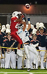 Beckman wide receiver leaps to make a catch over a University defensive back