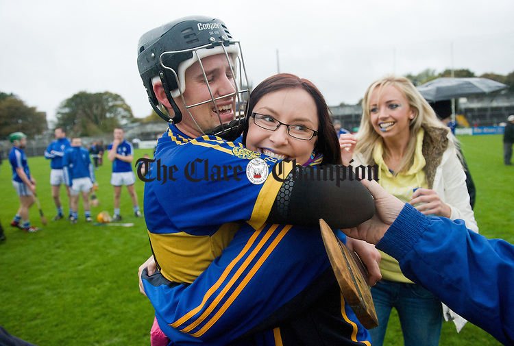 Newmarket's  Shane O Brien is congratulated by his girl friend Louise Raleigh at the end of the senior county hurling final at Cusack Park. Photograph by John Kelly.