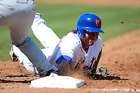 New York Mets outfielder Matt den Dekker #68 dives back to first on a pickoff attempt during an exhibition game against the Michigan Wolverines at Tradition Field on February 24, 2013 in Port St Lucie, Florida.  New York defeated Michigan 5-2.  (Mike Janes/Four Seam Images)
