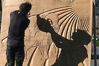Sculpteurs a la tronçonneuse