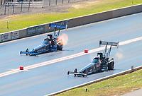 Jul 21, 2019; Morrison, CO, USA; NHRA top fuel driver Scott Palmer (right) alongside Cameron Ferre during the Mile High Nationals at Bandimere Speedway. Mandatory Credit: Mark J. Rebilas-USA TODAY Sports
