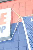 An American flag hangs from the outside of the building before Texas senator and Republican presidential candidate Ted Cruz speaks at a Second Amendment Rally outside Granite State Indoor Range in Hudson, New Hampshire.