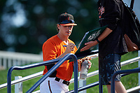 Frederick Keys pitcher Steve Klimek (27) signs an autograph for a fan before the first game of a doubleheader against the Lynchburg Hillcats on June 12, 2018 at Nymeo Field at Harry Grove Stadium in Frederick, Maryland.  Frederick defeated Lynchburg 2-1.  (Mike Janes/Four Seam Images)