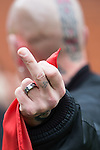 """© Joel Goodman - 07973 332324 . 28/03/2015 . Manchester , UK . A man with a swastika tattoo on his finger flips the bird . Approximately 100 neo-Nazis gather in Manchester for """" White Pride Worldwide day """" . Photo credit : Joel Goodman"""