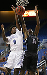 Desert Pines' Hasani Jameel and Cheyenne's Hahsonie Laushaul fight for a loose ball during the NIAA 3A state basketball championship game in Reno, Nev., on Saturday, Feb. 24, 2018. Desert Pines won 48-44 in overtime. Cathleen Allison/Las Vegas Review-Journal