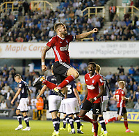 GOAL - Ipswich Town's Jordan Spence's goal has Luke Chambers jumping for joy during the Sky Bet Championship match between Millwall and Ipswich Town at The Den, London, England on 15 August 2017. Photo by Carlton Myrie.