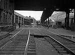 Pittsburgh PA: View of the Pittsburgh's Penn Station platform with yardman directing passengers.