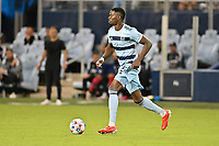 KANSAS CITY, KS - JULY 31: Nicolas Isimat-Mirin #5 Sporting KC with the ball during a game between FC Dallas and Sporting Kansas City at Children's Mercy Stadium on July 31, 2021 in Kansas City, Kansas.