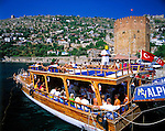 Turkey, Province Antalya, holiday resort Alanya: Red Tower and fortress, excursion boat with tourists